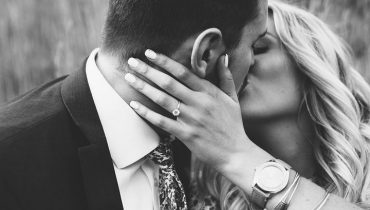 man and woman kissing after getting engaged